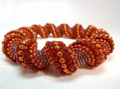 Flaming Sunset Cellini Spiral Beadwoven by littlestonedesign, $49.00