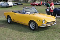 1970 Fiat 124 Spider Sport - yellow - fvr-1 by Rex Gray, I felt so cool driving this to school my senior year until I paged to the principal's office. The football team had picked up my Fiat and set it down on the front porch of the school blocking the entrance including the principal's office. Not cool!