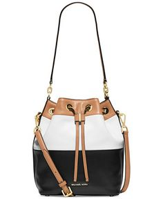 Laid-back, yet luxe in buttery-soft colorblock leather, this Michael Michael Kors bucket bag is at the top of every fashionistas most wanted list. The spacious interior fits everything you need, while