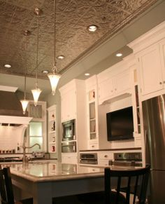 tin ceiling tiles in the kitchen, charming