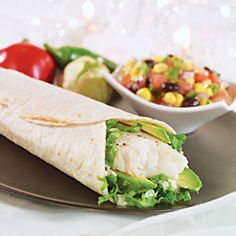 5-Minute Fish Wraps    Cook Time: 4 Min.  What you need:  * 4 tilapia, swai or catfish fillets (about 5 oz. each)  * 1 ripe avocado, peeled and pitted  * 1/4 c. Schnucks ranch or Caesar salad dressing or light sour cream  * 4 (10-in.) flour tortillas  * 1 c. Schnucks finely shredded cheddar jack cheese  * salt and ground black pepper    Optional fillings:  * thinly sliced iceberg lettuce  * chopped tomatoes  * sliced black olives  * thawed frozen corn  * drained black beans and/or  * salsa
