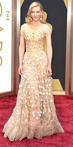 It may appear that Cate Blanchett is floating down the Oscars red carpet in her floral-adorned, illusion mock turtleneck (!) Giorgio Armani gown, but she admitted it's actually pretty heavy. (Cate, we'd gladly relieve you of the weighty dress at the end of the evening.) http://www.peoplestylewatch.com/people/stylewatch/package/gallery/0,,20768377_20792536_30112020,00.html