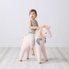 How AMAZING is this ride on pet unicorn from @thelandofnod?! We're obsessed! #miniproductlove