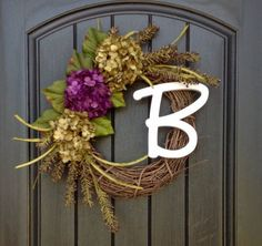 An original design by An Extraordinary Gift ©  NEW** Add a removable clip on Monogram Letter to your design! Monogrammed letter measures 9H.  I used an 18 grapevine base. I created a design featuring purple and green hydrangeas with an added touch of plum colored berry sprays. This design measures approx. 19 in diameter. This design would look wonderful on any door or wall in your home.  Giving An Extraordinary Gift is perfect for all occasions.  Sending a gift?? Have a question?? Convo me…