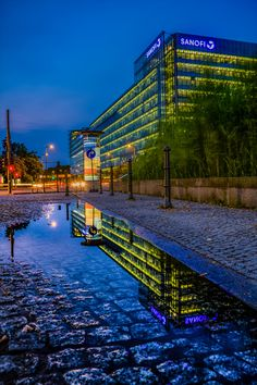 Robert Emmerich - 64 HDR - Puddle reflection on a rainy day in Berlin - Germany