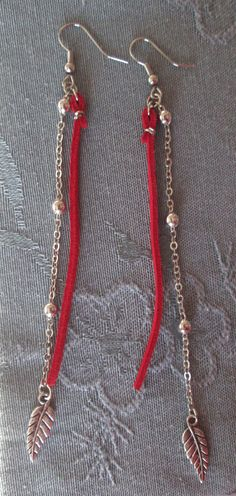 Red Faux Suede Cord & Ball Chain Earrings with Tibetan Silver Charms. $15.00, via Etsy.