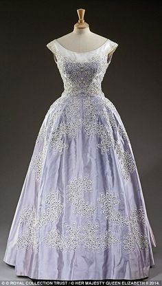 This dress was worn in 1962 for the King of Norway's visit, it has a bodice and full skirt are embroidered with beads, sequins, crystals