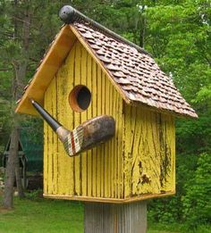 705D distressed yellow salvage wood birdhouse with antique golf club head perch and handle as roof apex recycledbirdhouse.com