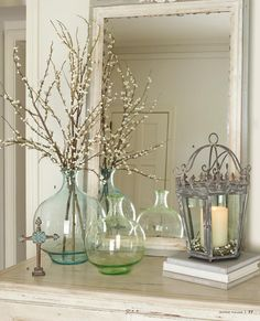 Pussy willow branches are my fav and these clear colored vases really set them off