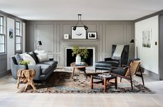 living-room-in-modern-farmhouse-renovation-gray-millwork-walls