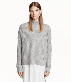 Gray melange. Relaxed-fit rib-knit sweater in a mohair blend. Mock turtleneck, dropped shoulders, long sleeves, and ribbing at neckline, cuffs, and hem.