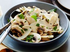 Fresh Mushroom and Parsley Salad : Giada's mushroom and parsley salad is light and fresh - the perfect side dish to balance out a rich cut of meat. Lemon juice brightens the flavor of the earthy mushrooms, and shaved Parmesan lends a hint of creaminess.