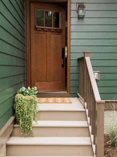 With major curb appeal, the renovated Craftsman style home fits right into the near-downtown neighborhood in Ann Arbor. Painted dark green with lighter green accents, a classic Craftsman palette, the design has a natural feel from the front door all the w Green Exterior Paints, Green Siding, House Paint Exterior, Exterior Paint Colors, Exterior House Colors, Exterior Doors, Green House Exteriors, Craftsman Exterior Colors, Stucco Exterior