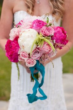 I'd love to have fuchsia pink and turquoise in my bouquet and everything...
