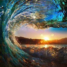 beautiful wave falling down at sunset