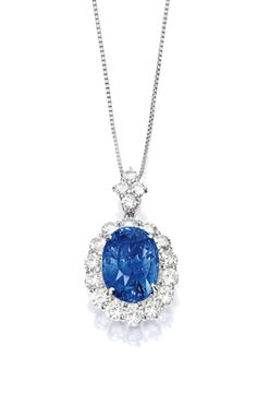 Sapphire and Diamond Pendant. Centring on an oval sapphire weighing carats, to a surround and surmount set with brilliant-cut diamonds together weighing approximately carats, mounted in platinum, accompanied by a link-chain, length approximately Blue Sapphire Necklace, Sapphire Pendant, Sapphire Jewelry, Diamond Pendant Necklace, Diamond Necklaces, Choker Necklaces, Diamond Jewellery, Chokers, Modern Jewelry