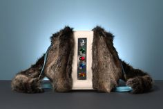 KULU multicolor. Multiuse: a backpack / a shoulder bag with adjustable shoulder straps. Made of luscious faux exotic skins and faux fur #NeverLeather #NeverFur
