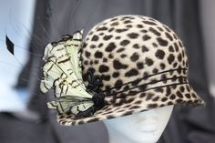 The base of Phryne's leopard-print hat was sourced from a company in America and the feathers are from a millinery supplier in London.