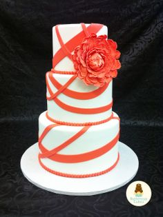 Love the fondant ribbons and the flower!