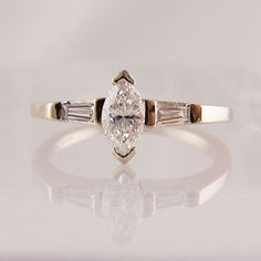 marquise cut diamond with tapered baguette cut shoulders