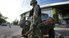 Thailand army declares martial law: A Thai soldier walks in front of the National Broadcasting Services of Thailand television station in Bangkok