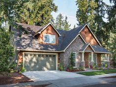 Eplans House Plan: With a nod to the details of the Arts and Crafts movement, this appealing bungalow has an eye-catching covered front porch, cedar-shingle accents, and light-catching windows. The main foyer separates a cozy