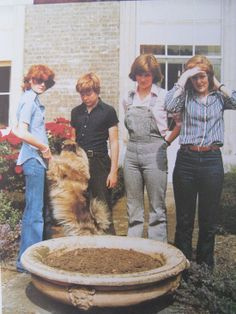 The four Spencer children in the garden at Althorp. (L to R: Sarah, Charles, Diana & Jane)