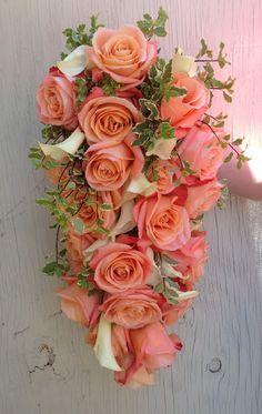 The Enchanted Florist - Coral rose and calla lily cascade bridal bouquet. #CoralBridalBouquet #CoralCascadeBouquet