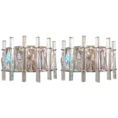 Pair of French Crystal Four-Light Sconces | From a unique collection of antique and modern wall lights and sconces at https://www.1stdibs.com/furniture/lighting/sconces-wall-lights/