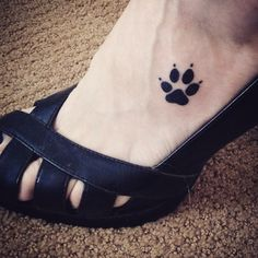 Dog paw print tattoo on foot, in memory of my furry bud.