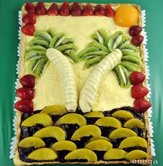 Fruit cake. Recipe of fruit cake: Island with palm trees. Ingredients: Banana, kiwi, apricot, strawberries, chocolate, cream. Easy, fast, beautiful and delicious