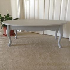 A unique cottage style coffee table hand painted in a light gray. Finished with light and dark wax. I didn't sand the edges because well, I just loved it they way it looked after it was painted and waxed.  Mary's Garden of Refinished Treasures  www.facebook.com