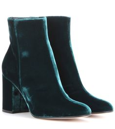Gianvito Rossi - Rolling 85 velvet ankle boots - Gianvito Rossi visits the English hunting forests for inspiration this season; the deep, green-blue hue of the Rolling 85 velvet ankle boots is pulled from the shadows of overhanging trees. Luckily, there's no need to bring these along on the hunt – they're at ease in the concrete jungle. It's an elegant, clean silhouette that will pair well with skirts and skinny jeans alike. seen @ www.mytheresa.com