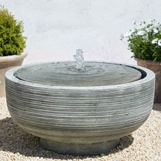 """Campania International Girona Bird Bath Fountain: entire bowl holds water so refilling will be less frequent. The depression near the copper spout is about 2"""" and the rest is ankle deep for the birds to feel secure. It is difficult to find a fountain that is suitable for birds. This is the one."""