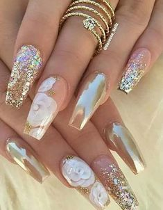 Using the classic long acrylic nails designs 2018 combination along with added glitter to create this cute acrylic nail design is a sure way to incorporate love and a glamour quotient together. Pink and silver have long been one of the most favored nail paint combinations and with good reason.