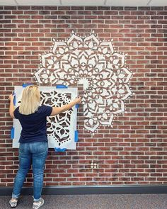Painted faux brick accent wall ideas on a budget using easy to use DIY brick stencils and mandala stencils from Cutting Edge Stencils