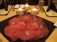 Good centerpiece idea for tables, just bunch tulle and place whatever piece you have on top.