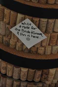 wine cork cake box.  Guests write a note and then tack it to the corks~cute idea.  Now I know what to do with all my corks