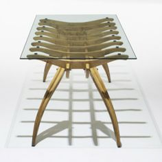 FRANCO CAMPO AND CARLOGRAFFI  Millepieditable  Italy , 1952/c. 1975 acero, glass, brass 83.25 w x 36 d x 30.75 h inches  PROVENANCE: Priva...