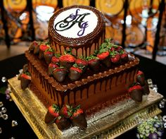 Chocolate-covered strawberries give a monogrammed groom's cake some extra appeal.