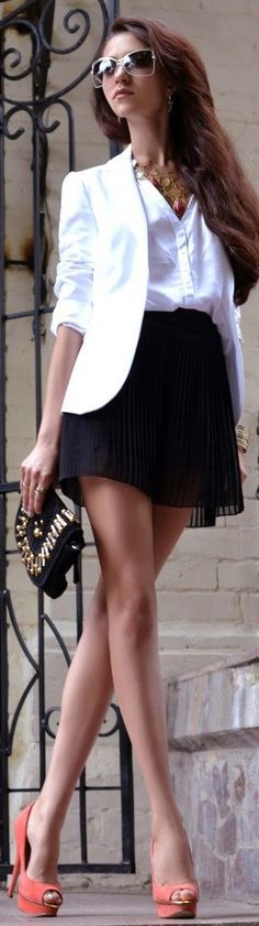 White blazer, black skirt, colorful heels
