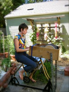 The bicycle powered drum carder in action