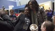 """First lady Michelle Obama poses for photos after reading """"Twas the Night Before Christmas"""" to a group of children at the Children's National Health System in Washington, Monday, Dec. 14, 2015. Her appearance continued a first lady tradition that dates back more than 60 years to Bess Truman, who first brought holiday cheer to children not well enough to leave the hospital in time for Christmas. (AP Photo/Susan Walsh)"""
