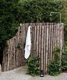 This is an image that had a bad link. I'm uploading the image b/c it is inspiring. I like how the rough cut timber is creating the shower walls. Would be an amazing outdoor shower.