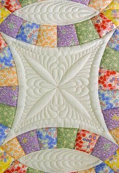Close-up, Double Wedding Ring quilt: quilting design by Kim Brunner                                                                                                                                                     More