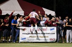Midfielder Daniel Lovitz celebrates with Phoenix fans after scoring #Elon's game-winning goal in a Top 25 contest against Wake Forest.