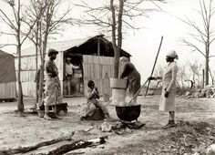 """Nov. 1939. Butler County, Missouri.  """"Washing clothes at camp for evicted sharecroppers"""" Photo by Arthur Rothstein"""