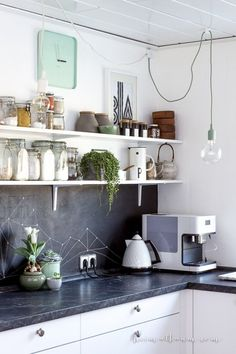 Make a chalk paint backsplash in your kitchen and create your own patterns.