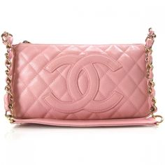 This is an authentic CHANEL Caviar Quilted Pochette Pink.   This chic pochette is finely crafted of pink diamond quilted luxurious caviar leather.