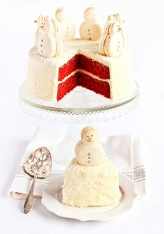 Christmas Red Velvet Snow Cake with Snowman Macarons by raspberri cupcakes...maybe substitute coconut with shaved white chocolate???